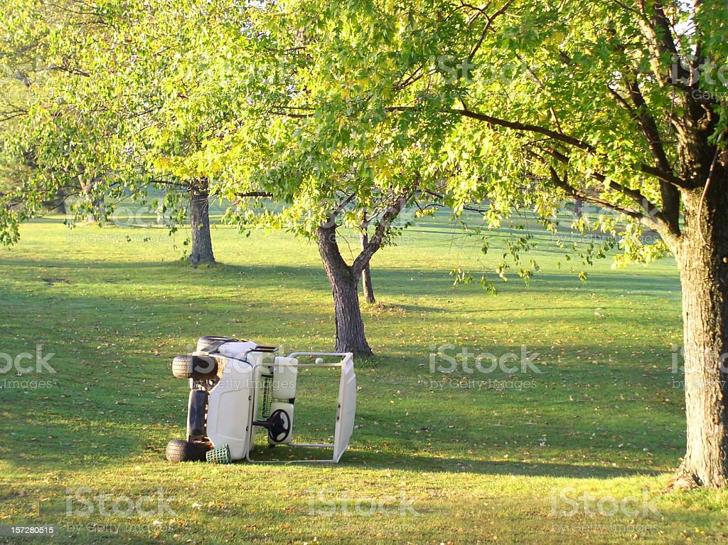 Golf Cart Accident Overturned on its Side stock photo