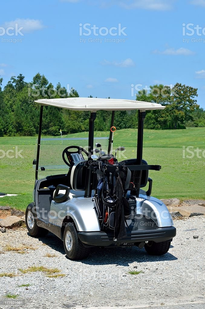 Golf cart and clubs royalty-free stock photo