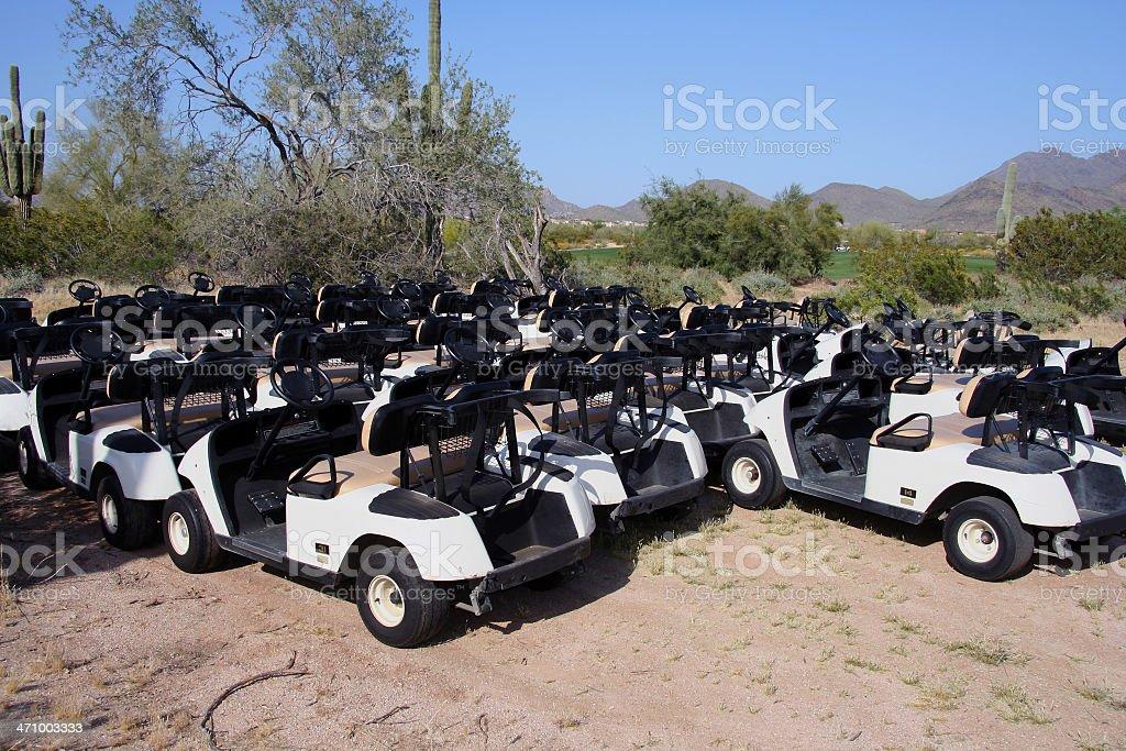 Golf carts desert parking 3 royalty-free stock photo