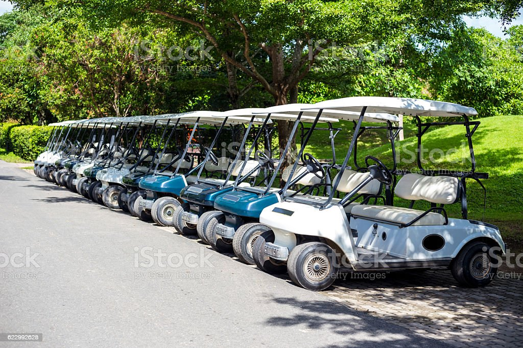 Golf carts waiting for service at the golf course stock photo