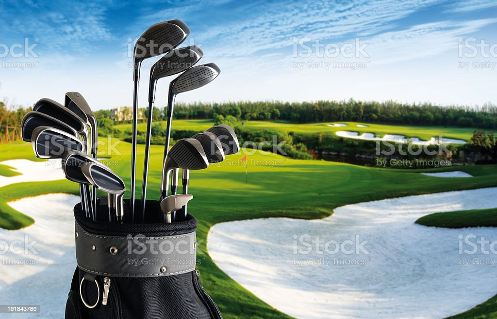 Golf Club And Bag With Fairway Background - XXLarge royalty-free stock photo