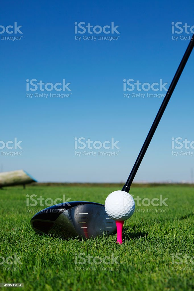 Golf club and ball in grass stock photo