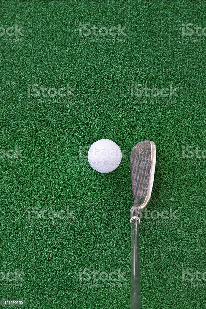 golf club and ball on the artificial turf stock photo