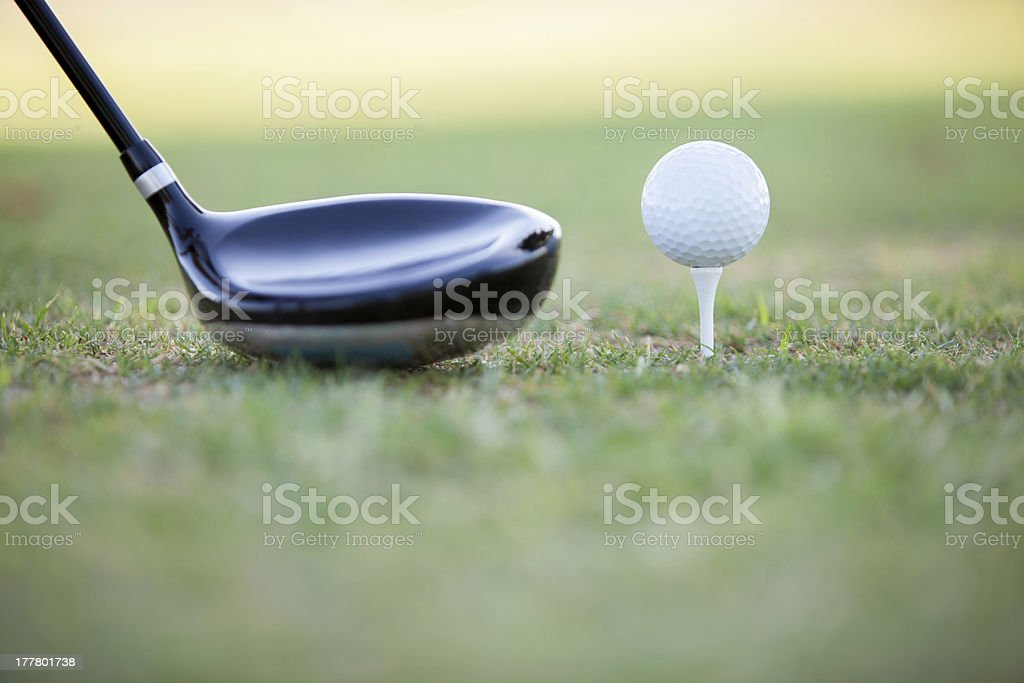 Golf club and ball ready for tee off royalty-free stock photo