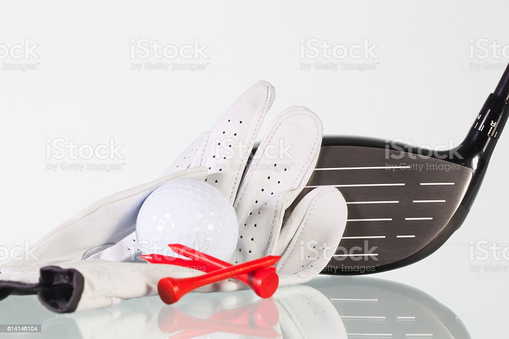 Golf club on a glass table stock photo