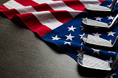 Golf club with flag of USA on black table