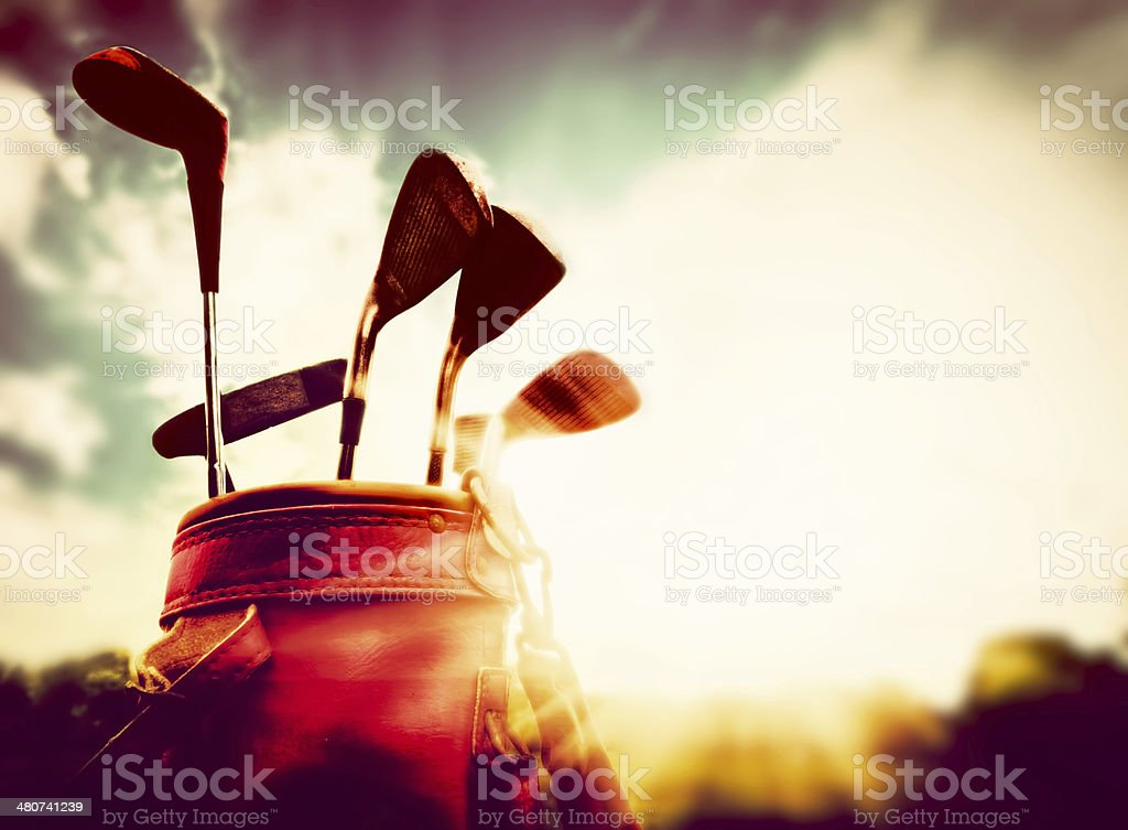 Golf clubs in a leather baggage vintage style at sunset stock photo