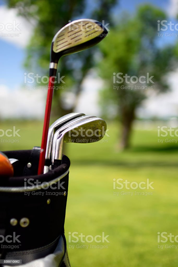 Golf clubs in bag stock photo