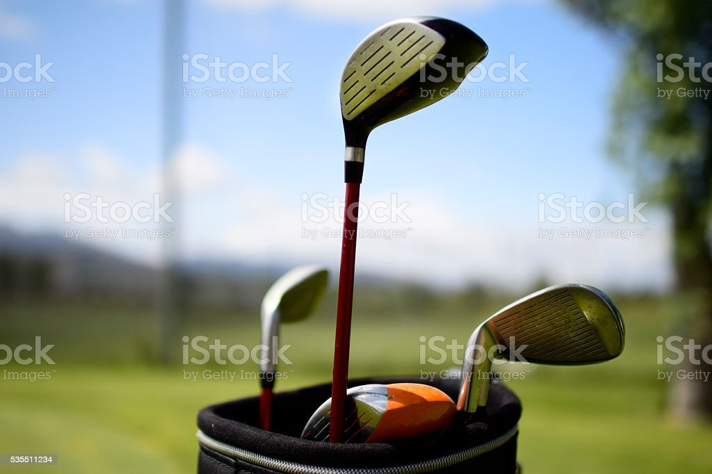 Golf clubs in bag used stock photo