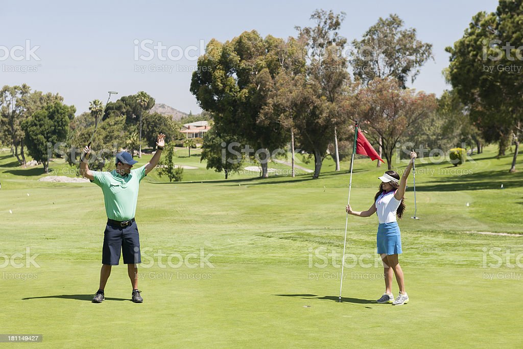 Golf Couple Putting royalty-free stock photo