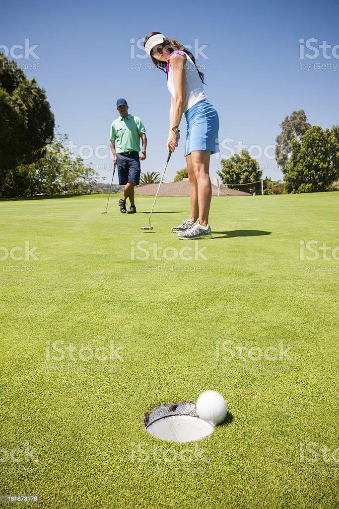 Golf Couple Putting stock photo