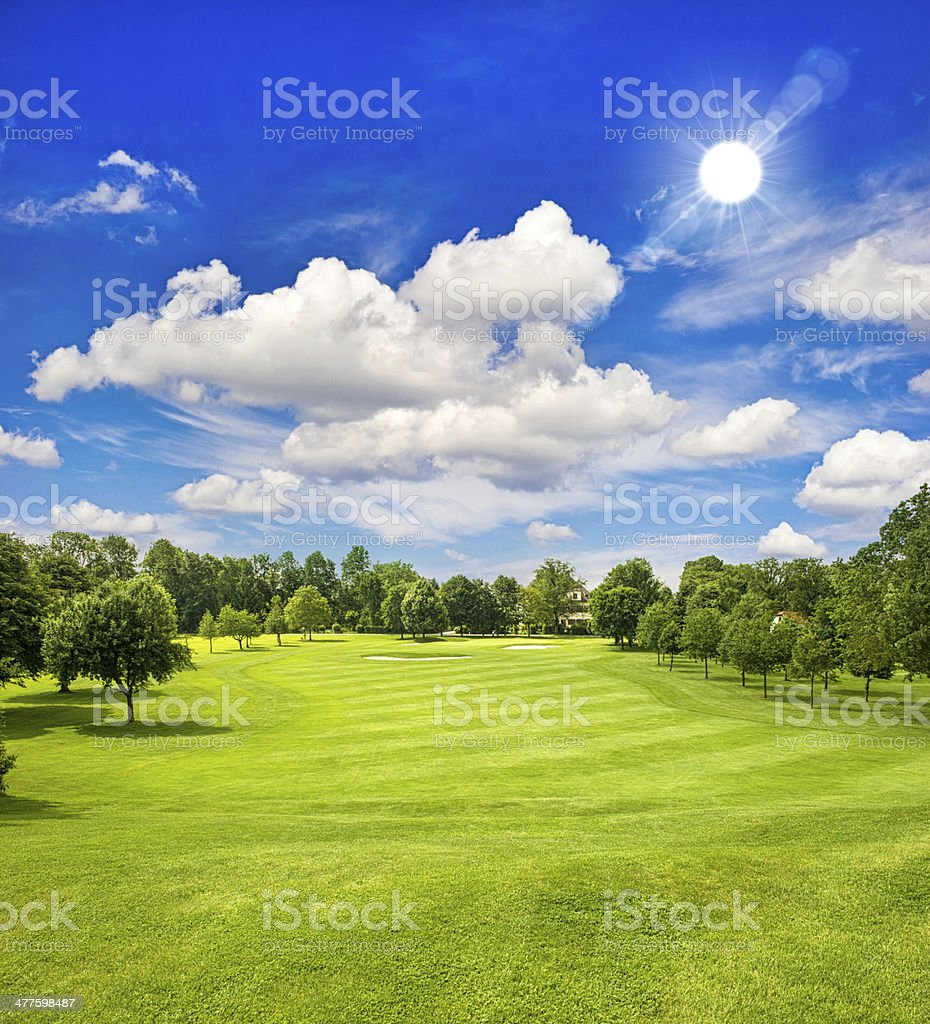 golf course and blue sunny sky. green field landscape stock photo