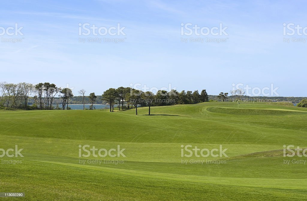 Golf course, country club overlooking ocean royalty-free stock photo