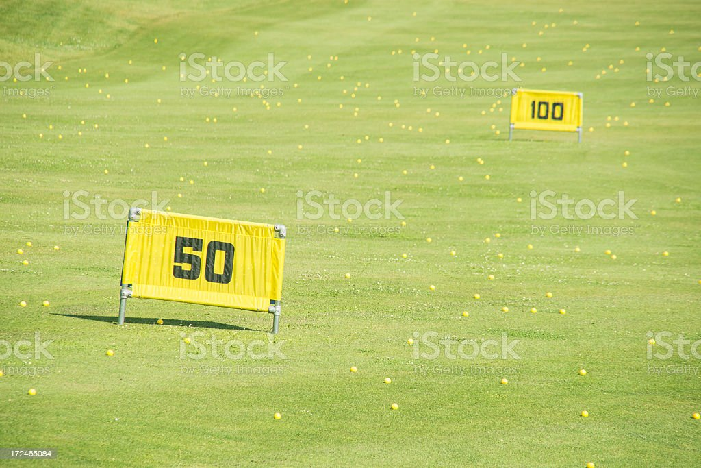 Golf course driving range with yellow balls royalty-free stock photo