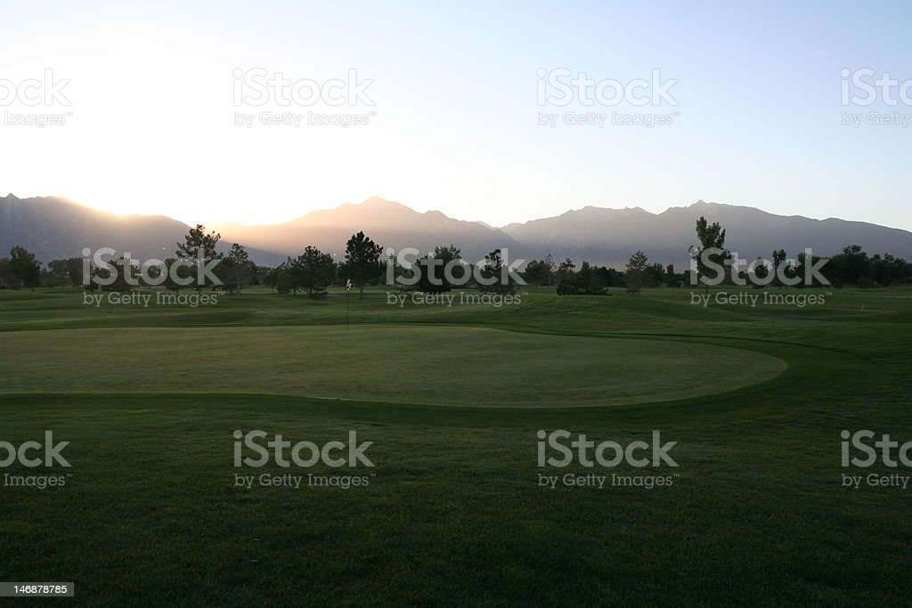 Golf course just before sunrise royalty-free stock photo