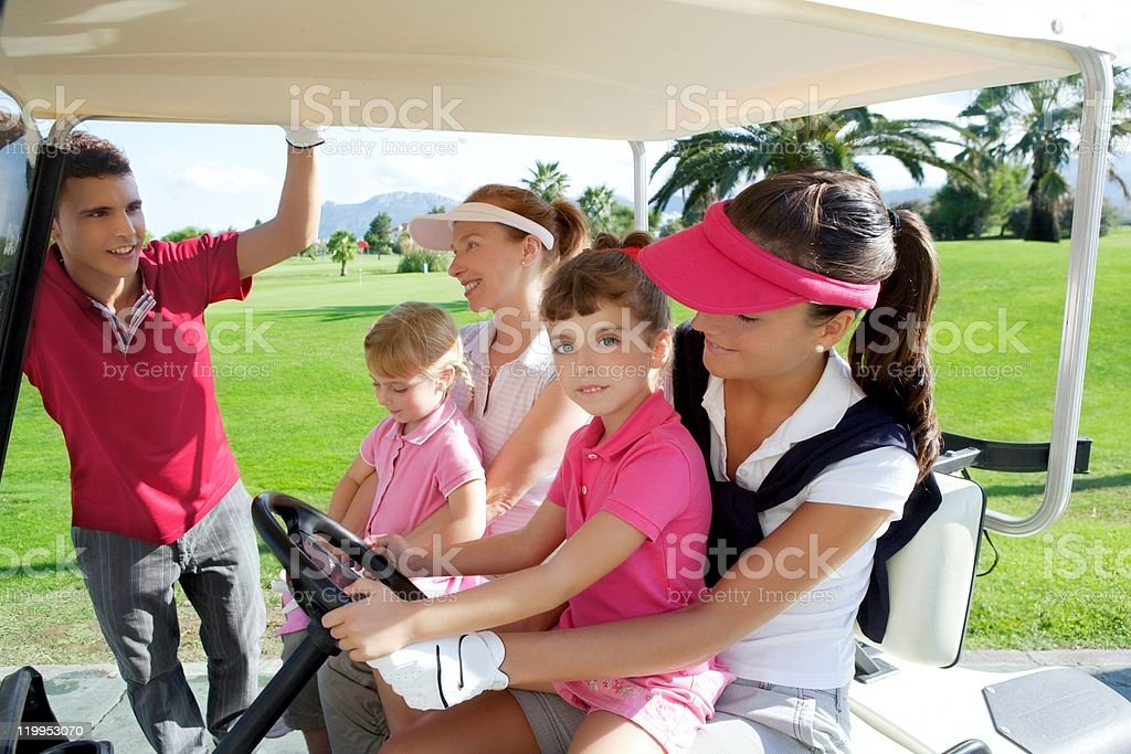 golf course mothers and daughters in buggy royalty-free stock photo