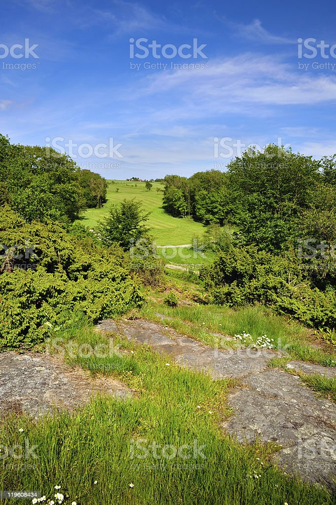 Golf course on hill with rocks royalty-free stock photo