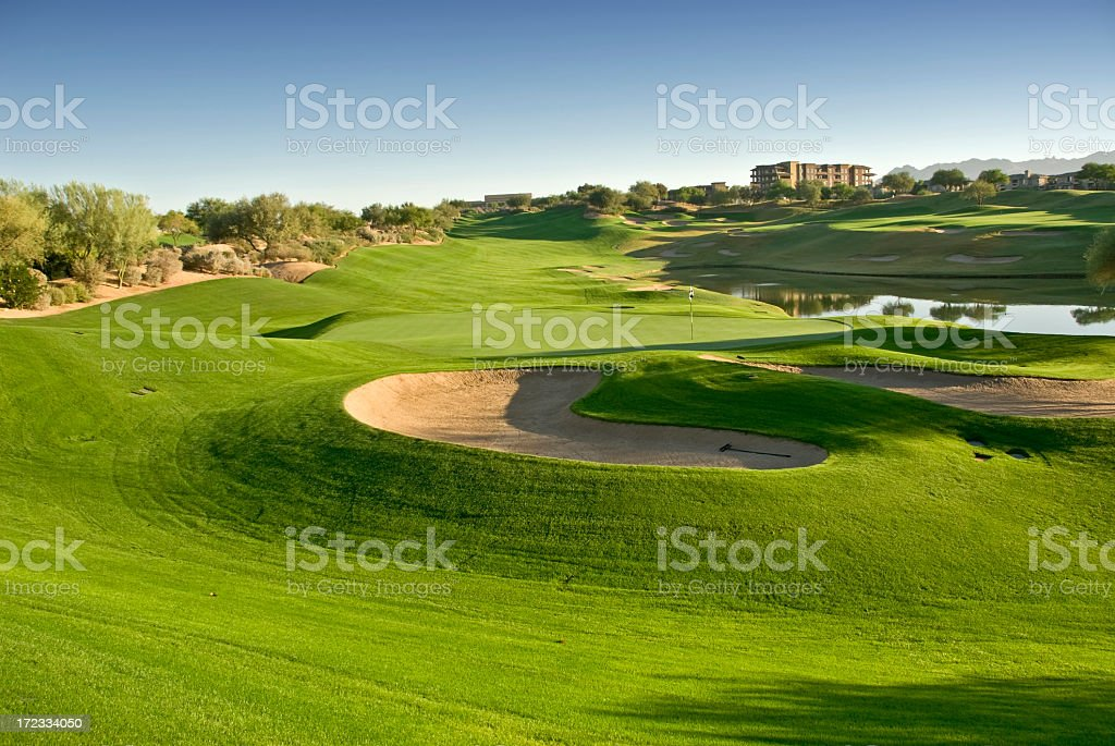 A golf course with a castle in the background royalty-free stock photo