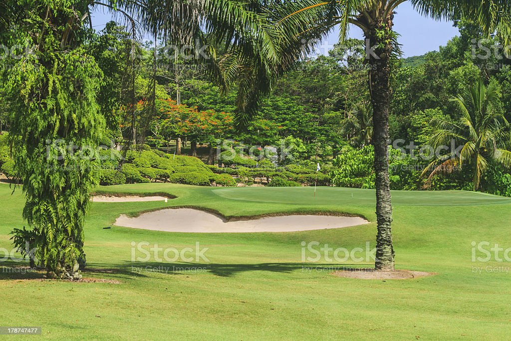 Golf course with bunker and green royalty-free stock photo