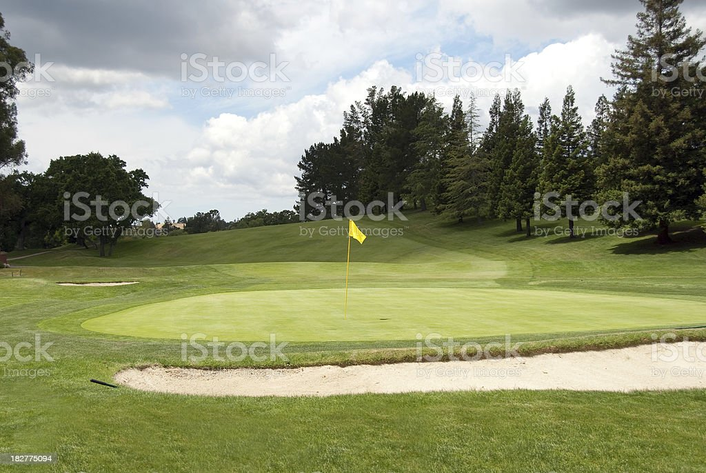 Golf Course with Green and Sand Trap royalty-free stock photo