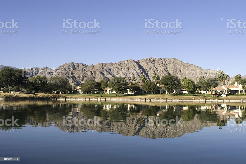 Golf course with lake royalty-free stock photo