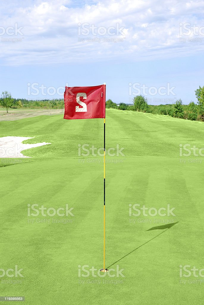 golf course with red flag royalty-free stock photo
