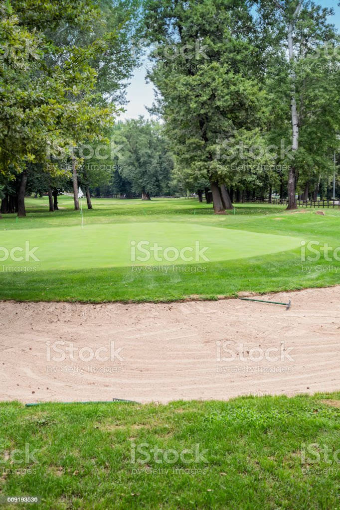 Golf course with sand bunkers 2 stock photo