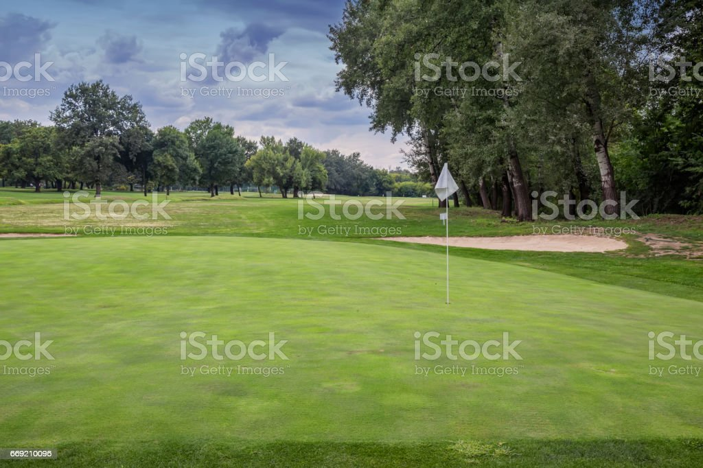 Golf course with sand bunkers stock photo