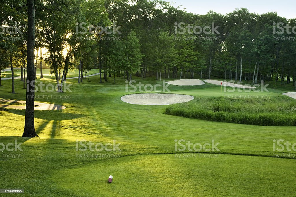 Golf course with sand traps on a sunny day stock photo
