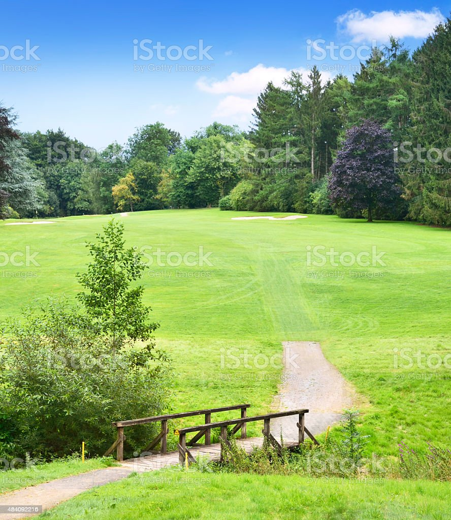 Golf course with wooden footbridge stock photo