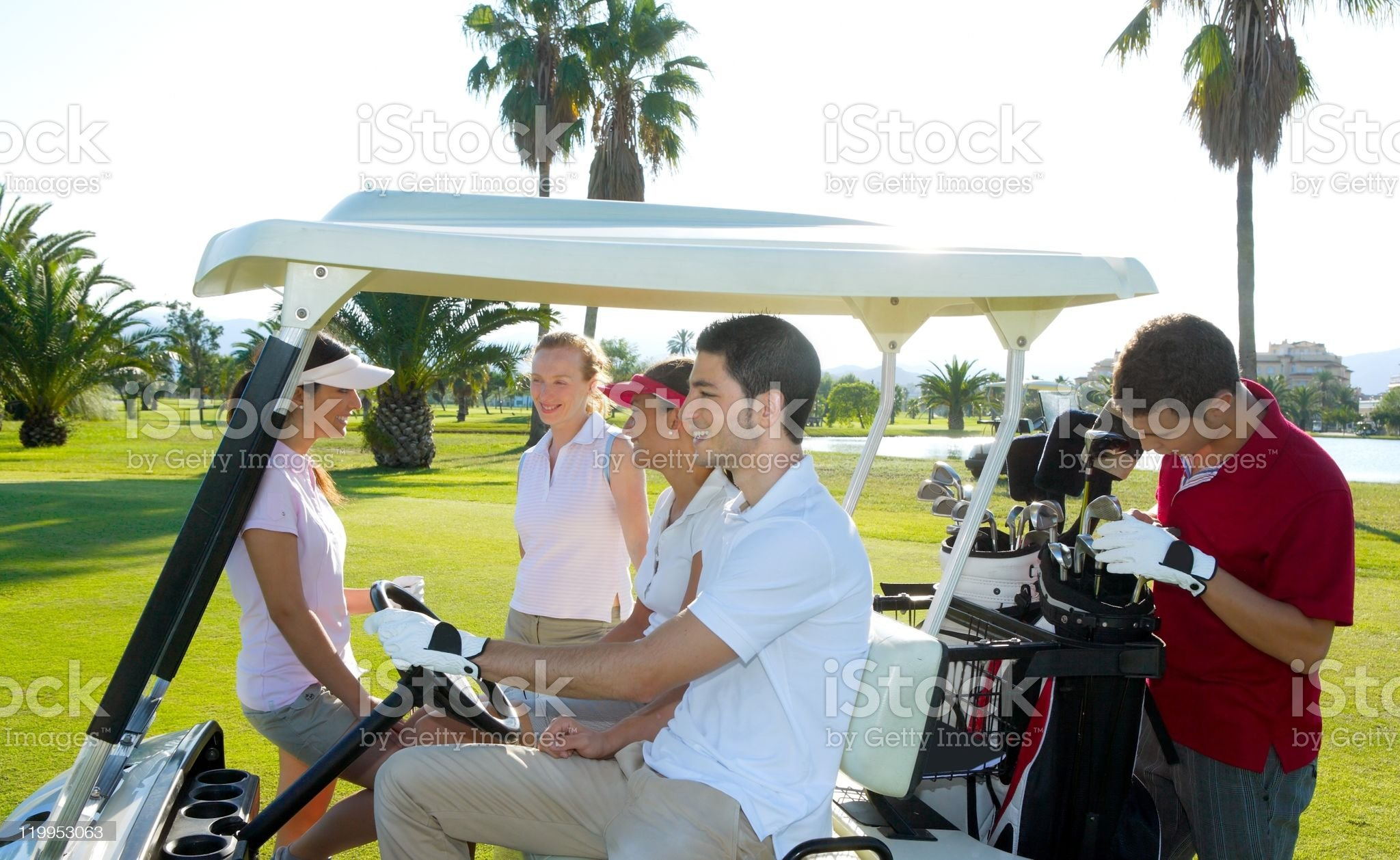 Golf course young people group buggy green field royalty-free stock photo