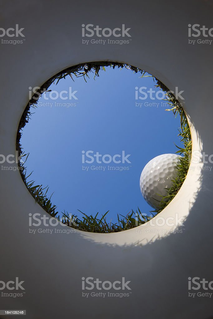 Golf Cup from Underneath the Green stock photo