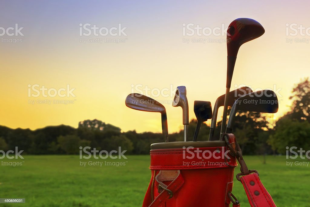 Golf equipment. Professional clubs at sunset stock photo