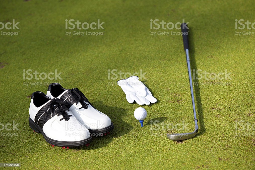 Golf Equipments on putting green royalty-free stock photo