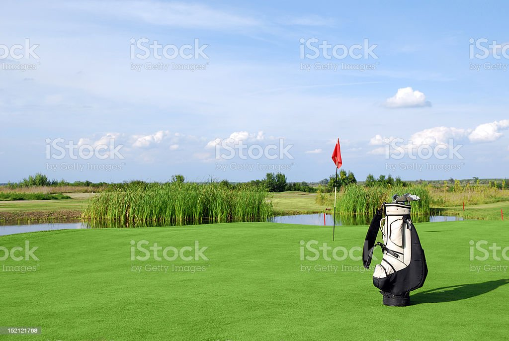 golf field with flag and bag royalty-free stock photo