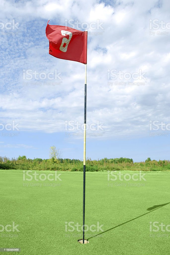golf field with red flag royalty-free stock photo