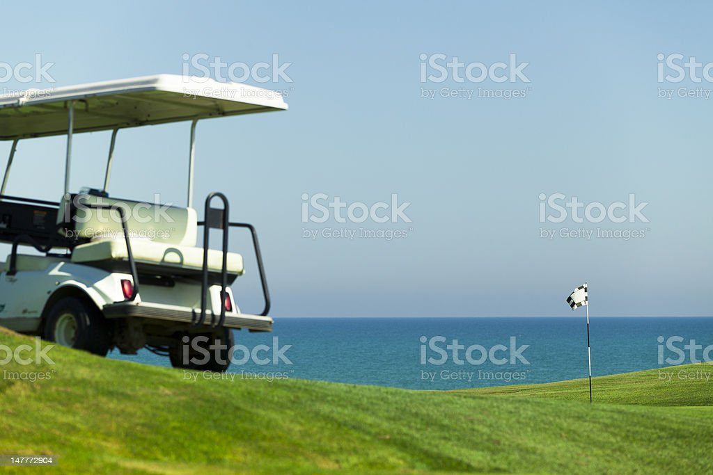 golf flag and cart on the course royalty-free stock photo