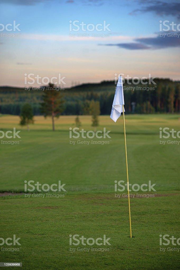 Golf flag at sunset royalty-free stock photo