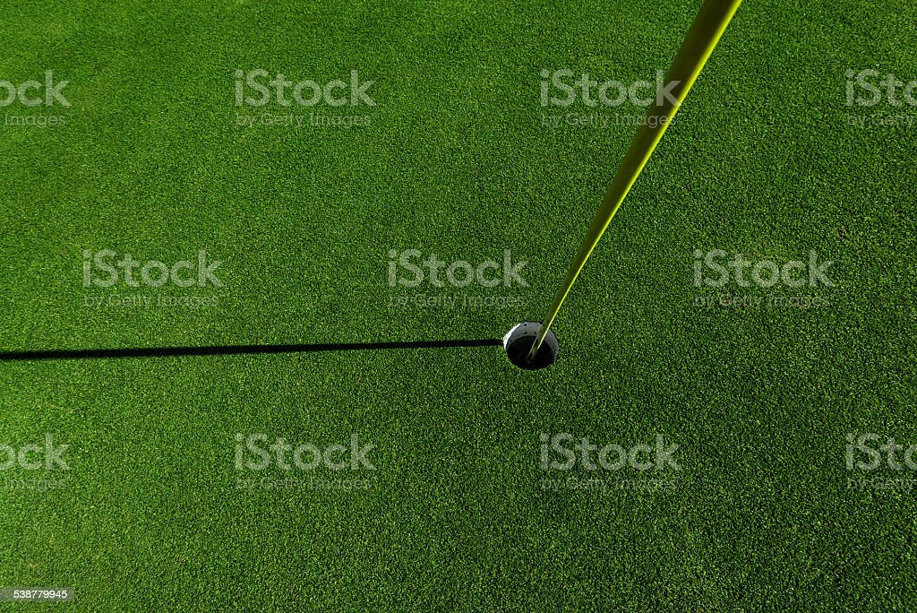 golf flag in hole stock photo