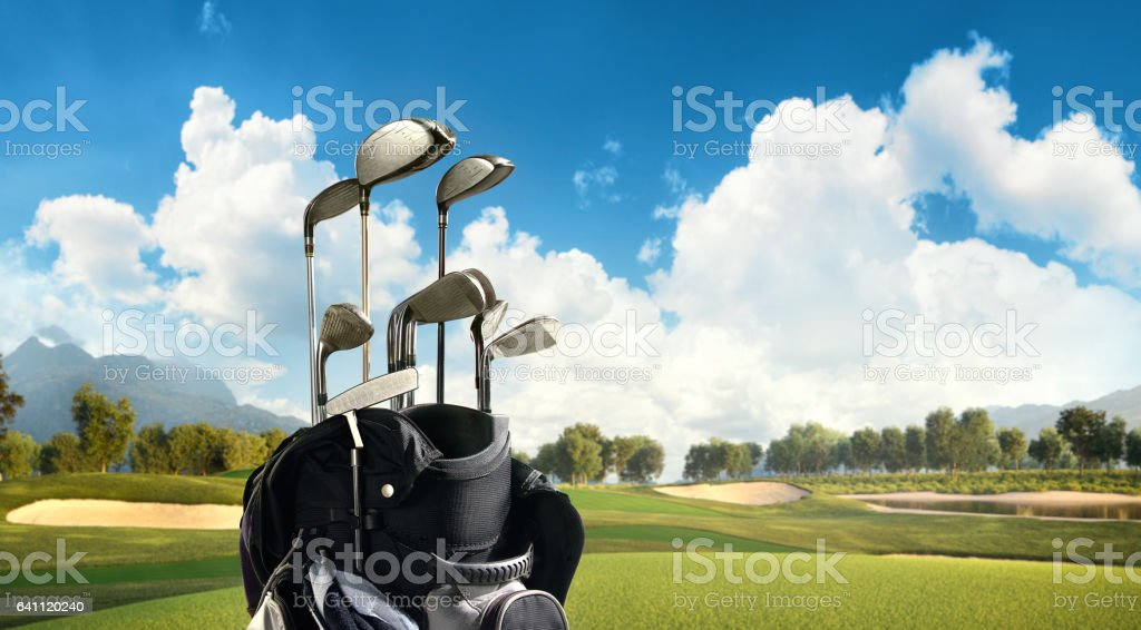 Golf: Golf course with a golf bag stock photo