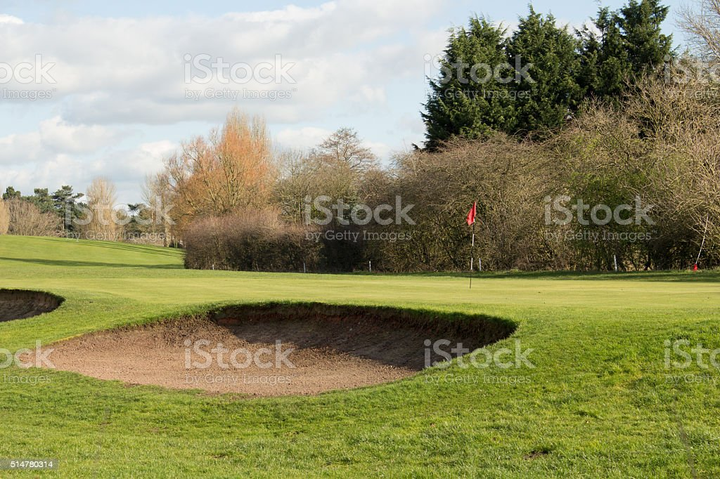 Golf Green And A Sand Bunker On A Sunny Day stock photo