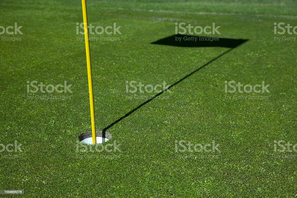 Golf green and flag shadow royalty-free stock photo