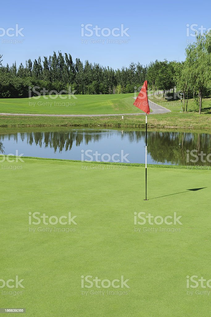 Golf Green and Red Flag - XLarge royalty-free stock photo