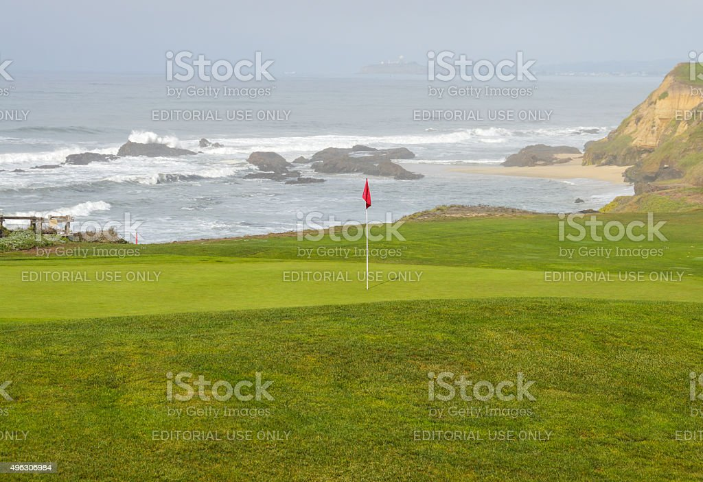 Golf green by the coast stock photo
