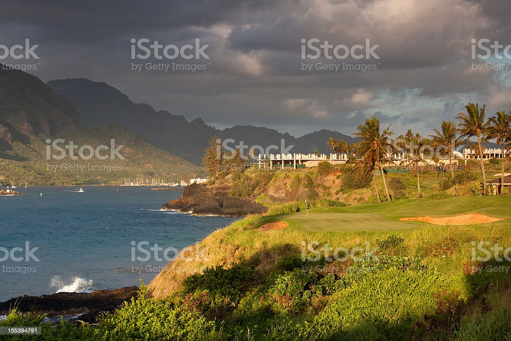 Golf Green By the Sea with Dramatic Sky royalty-free stock photo