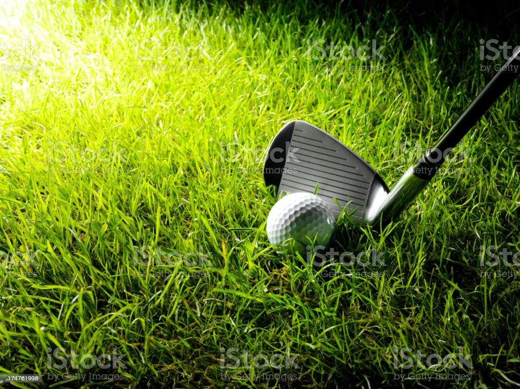 Golf club and golf ball on grass with copy space.Click on the link...