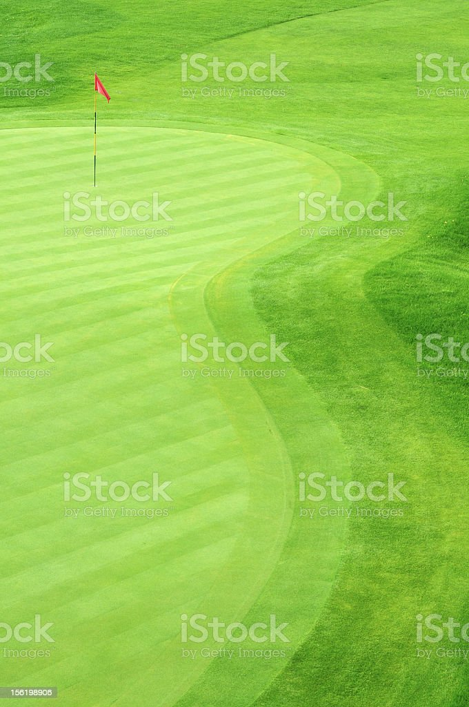 Golf green with grass in several green tones stock photo
