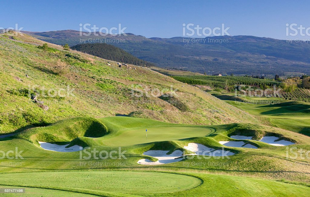 Golf Green With Sand Bunkers stock photo