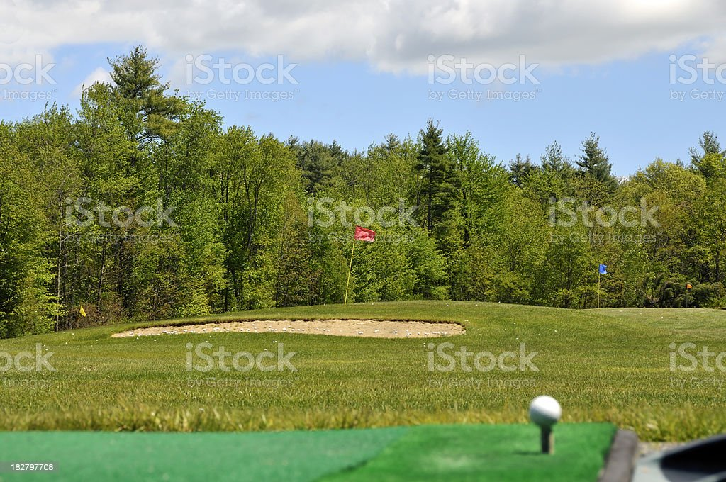 Golf Hole Beyond a Sand Trap royalty-free stock photo