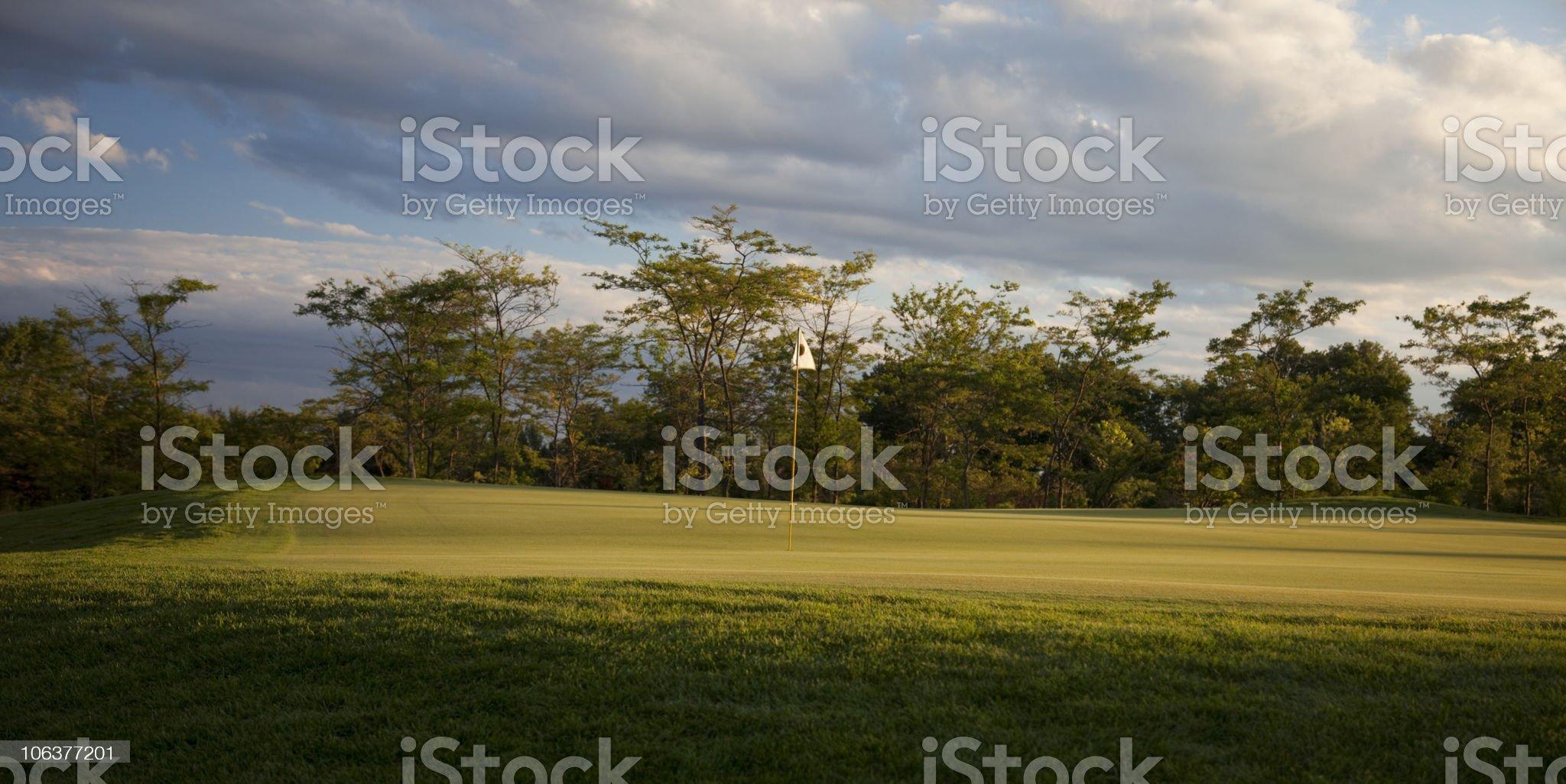 Golf hole in sunrise light. royalty-free stock photo